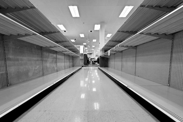 Empty aisle at the Target store in Gaithersburg, Maryland that would normally be filled with paper towels. Due to panic buying following the declaration of a pandemic and advisories to stay at home, people bought out stores' supplies of paper towels, toilet paper, bread, milk, and cleaning supplies.