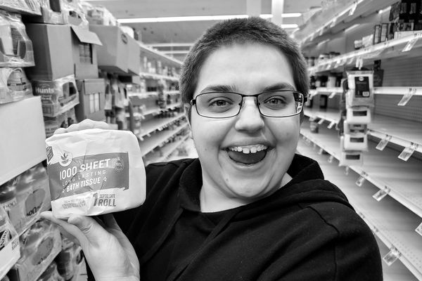 Elyse Horvath expresses her delight in finding a roll of toilet paper for sale at a Giant Food store in North Bethesda, Maryland.