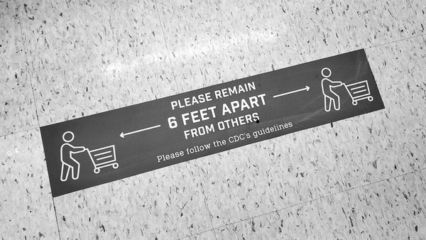 Floor marker at a Giant Food store in North Bethesda, Maryland reminding customers to practice social distancing, i.e. maintaining a six-foot distance from others.