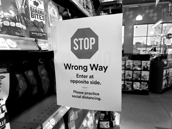 """One-way traffic sign indicating the """"wrong"""" direction of traffic flow in an aisle at Whole Foods Market in Ashburn, Virginia."""