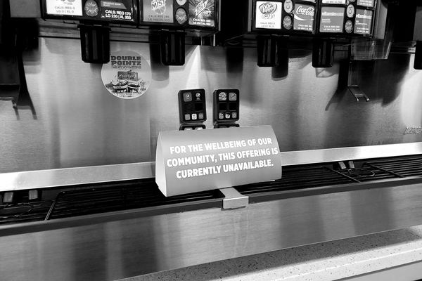 Signage on the soft drink fountain at a Sheetz in Leesburg, Virginia indicating that self-service beverages have been temporarily discontinued, ostensibly for the well-being of the community.