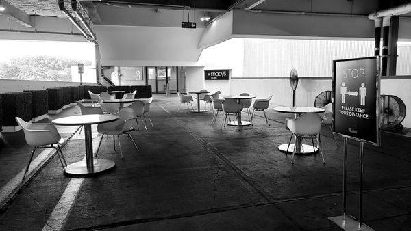 Temporary outdoor seating area in the parking garage at Montgomery Mall, a shopping mall in Bethesda, Maryland.