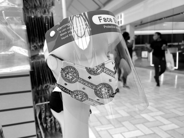 Mask and face shield on a mannequin at Tysons Corner Center in McLean, Virginia.