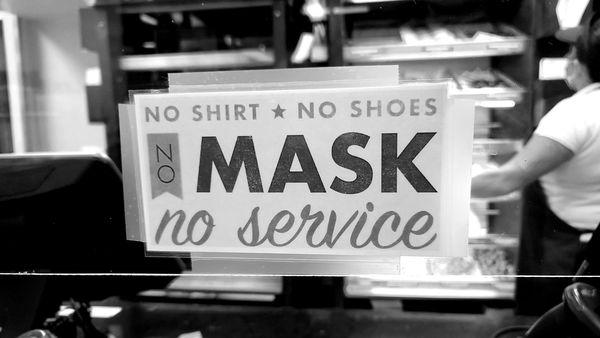 """Sign at a Dunkin Donuts in Leesburg, Virginia, reading, """"No shirt, no shoes, no mask, no service."""""""