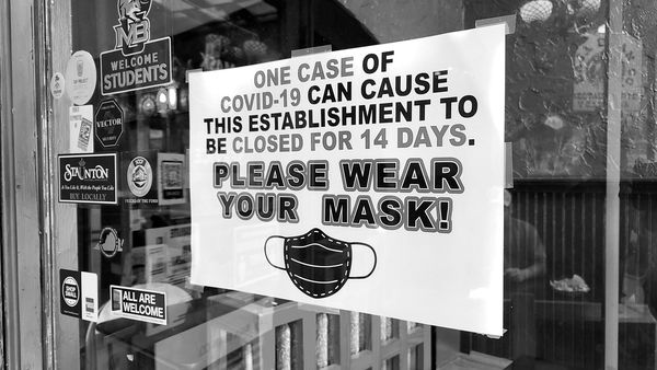 Sign on the entrance of Baja Bean Company in downtown Staunton, Virginia, pleading to customers to wear masks in the establishment. The ask from the restaurant was made in the context of ensuring that the facility remains open, i.e. if patrons do not wear masks and someone contracts COVID-19, the restaurant will be forced to close for two weeks.