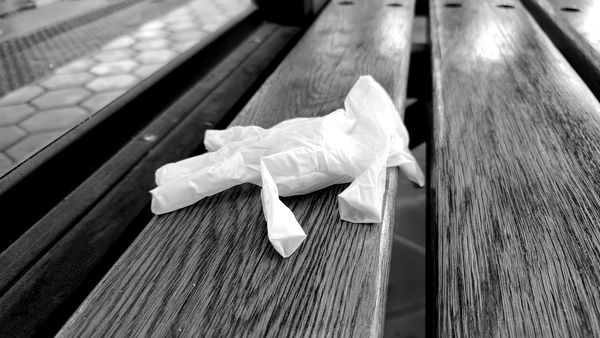 Discarded latex glove on a bench at West Falls Church station in Fairfax County, Virginia.