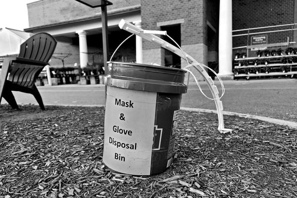 Mask and glove disposal bin outside of the Lowe's store in Gaithersburg, Maryland, presumably placed to limit the amount of litter in the parking lot caused by the irresponsible disposal of masks and gloves.
