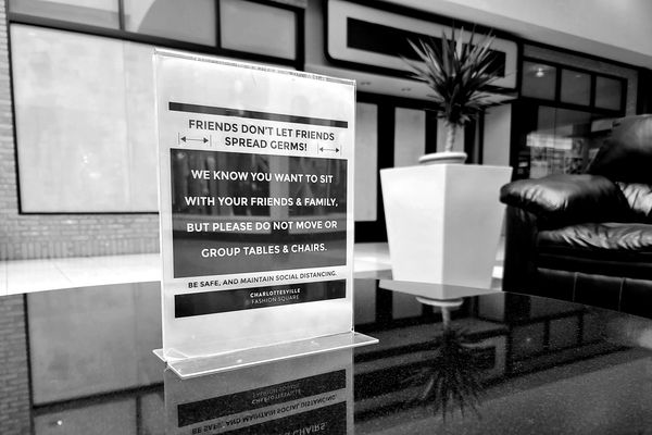 Sign on a table in a seating area at the Fashion Square mall in Charlottesville, Virginia, asking that furniture not be moved in order to maintain social distancing.