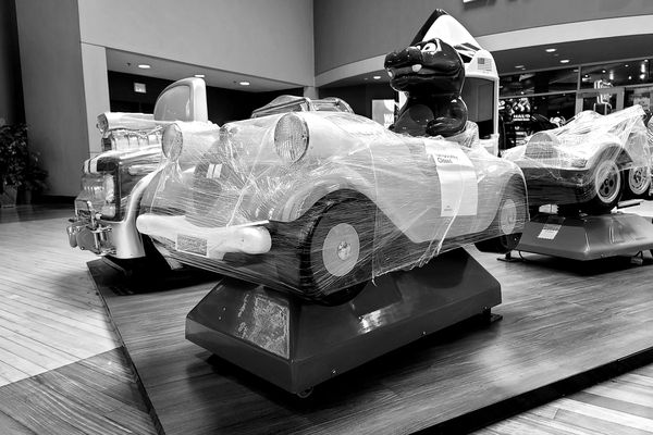 Children's ride wrapped in plastic with a sign indicating its temporary closure, ostensibly to prevent the spread of COVID-19, at the Arundel Mills shopping mall in Hanover, Maryland.