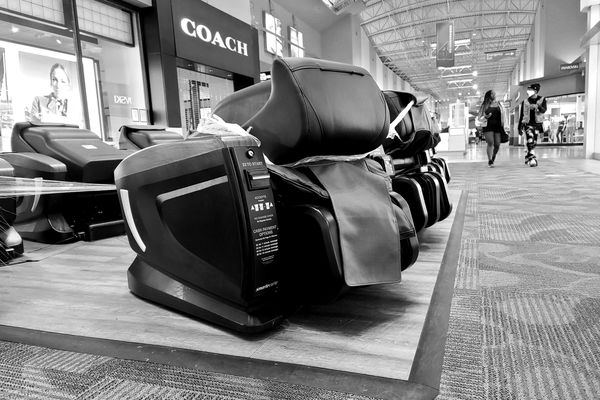 A row massage chairs, closed in an apparent effort to limit the transmission of COVID-19, at the Arundel Mills shopping mall in Hanover, Maryland.