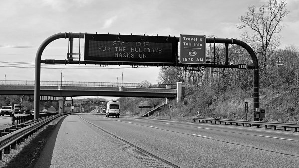 Electronic highway sign displaying a message discouraging travel and encouraging mask wearing, ostensibly to prevent the spread of COVID-19, on Maryland Route 200 westbound in Prince George's County, Maryland.