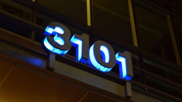 Lighted address numbers for 3101 Wilson Boulevard in Arlington, Virginia's Clarendon neighborhood.