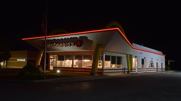 McDonald's restaurant with retro styling in Ranson, West Virginia, with lights turned off shortly after closing.