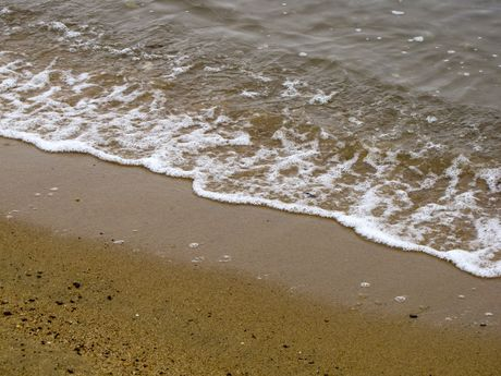 Waves from the Chesapeake Bay arrive on the beach.