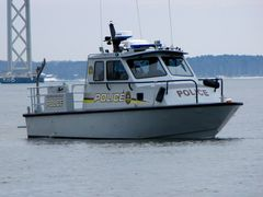 Maryland Transportation Authority Police boat a few hundred yards offshore.