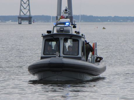 Maryland Natural Resources Police boat a few hundred yards offshore.