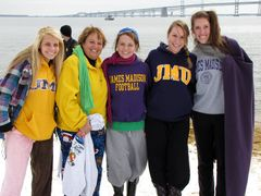 A group of three JMU students (at right), a JMU parent (second from left), and a community college student with aspirations of attending JMU in the future (far left).