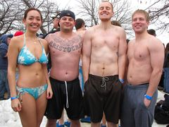A group smiles for the camera just ahead of the first plunge. Based on the facial expression, the man at second from right is very cold.