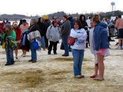 People wait on the beach ahead of the beginning of the second plunge.