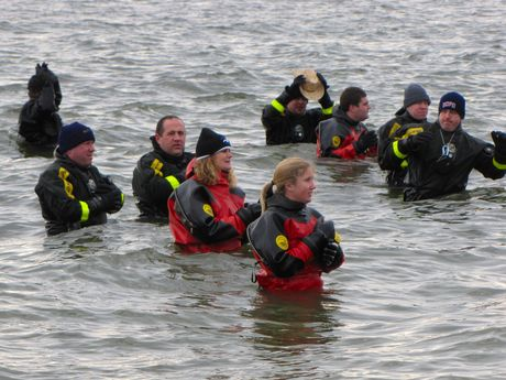 The support personnel in drysuits are back in the water, ready to go for the second plunge.
