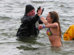 One of a number of women during the second plunge who, when plunging, went out to the people in drysuits and gave them high fives.