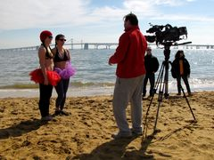 Two women are interviewed on the beach for WBAL, the NBC affiliate for the Baltimore area.