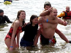 Members of the Sandy Spring Volunteer Fire Department take the plunge in the Chesapeake Bay.