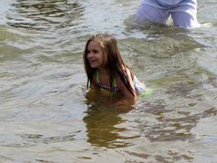 A young girl smiles in the waters of the Chesapeake Bay.