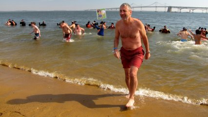 A man exits the water following his successful completion of the plunge.