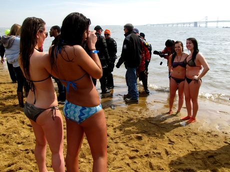 Two women take photos of two other women after having completed the plunge.