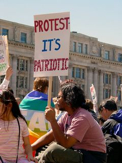 Those protesters who brought homemade signs, however, were much more memorable. One theme was patriotism. Peace is patriotic, and protesting is patriotic, according to these signs.