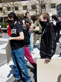 Just up from the chalk writer, I ran into two masked protesters using black bloc techniques. These two gentlemen were milling about like everyone else. Those demonstrators in black bloc eventually gathered at the west end of the plaza.