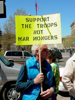 These protesters' signs reflect my own personal sentiment regarding the war. We support our troops, who are doing their best defending our honor. Now, the President and his folks on the other hand... that's another story.