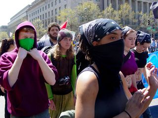 """Soon after the last photo was taken, the black bloc expanded their presence out into 14th Street, essentially blocking traffic, to the chant of, """"Whose streets? Our streets!"""""""