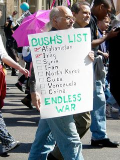This protester's sign expresses straight up what a number of protesters were afraid of. That being the thought that it seems like Bush has a laundry list of nations to invade and conquer.