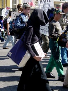 One woman simply dressed in mourning and carried a sign while marching.