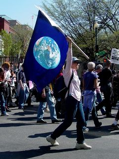 This protester carries a flag... this one simply showing the Earth on it, reminding us that we are not only citizens of our respective countries, but also citizens of the world.