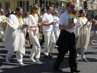 """These people, dressed in white, don't even need signage. By their flowing outfits alone, they state """"Peace""""."""