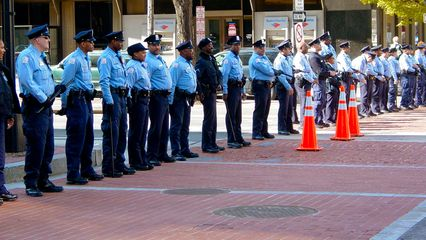 At intersections, DC Police formed lines to keep the protesters on the correct route.