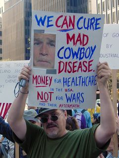 This protester is holding a sign with an idea that I was surprised didn't surface a long time ago... the whole idea of George Bush being like a cowboy.