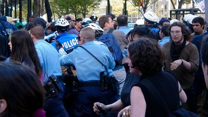 """Soon after the black bloc demonsrators passed through, the police decided to bust a move and converge on someone or something. I don't know what caused the action or what the action was targeted against. I was facing the other way when it started, photographing something else. Protesters yelled out, """"Shame! Shame! Shame!"""" as the police did their thing."""