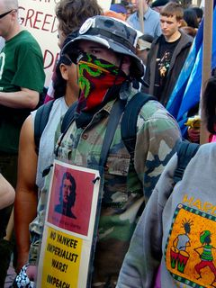 This masked protester, dressed in army fatigues, advocated no imperialist wars, displayed a picture of Che Guevara, and called, like a number of others, for the impeachment of George Bush.