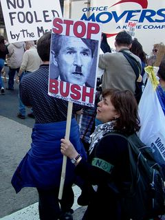 This protester decorated a picture of Bush to appear like Hitler, adding a bit of hair that Bush naturally doesn't have to increase this appearance. This was not the only case where Bush was likened to Hitler, but by far the most dramatic illustration.