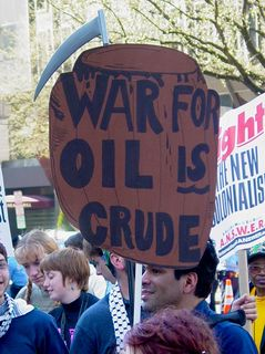 """Finally, with a play on the term """"Crude Oil"""", this protest sign tells us that war for oil is crude."""