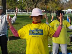 A group meditates while advocating for the release of Falun Gong practitioners in China.