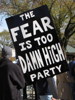 """Spoofing Jimmy McMillan's """"Rent Is Too Damn High Party"""", this protest sign advertises """"The Fear Is Too Damn High Party""""."""