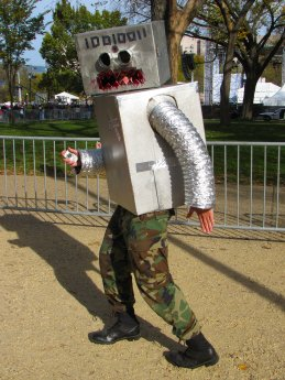 """A person dresses in a """"Metal as F---"""" robot costume."""