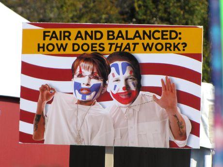 "A sign spoofing Sarah Palin, Glenn Beck, and the Fox News ""Fair and Balanced"" slogan."