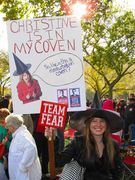A woman dresses as a witch while spoofing then-Delaware Senatorial candidate Christine O'Donnell with her protest sign.