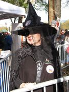 A woman dresses as a witch, spoofing then-Delaware Senatorial candidate Christine O'Donnell.